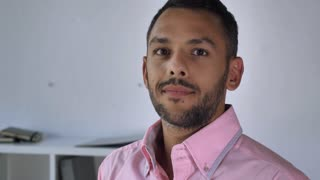 Happy smiling mixed race handsome man portrait. Adult businessman posing in office. Friendly employee wearing in casual shirt looking at the camera