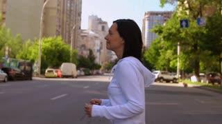 healthy lifestyle in urban city. caucasian girl enjoying the morning jogging. happy runner runs along the road