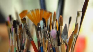 Paintbrushes is ready for painting. Brushes in a glass.