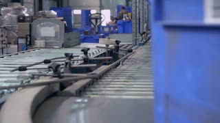 Parcels in blue box on conveyor sorted for dispatch