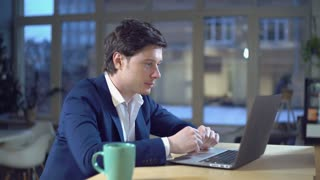 Portrait caucasian thirty years man greeting client give advice or online consultation Handsome businessman wearing in fashionable jacket talking with friendly smile looking on screen laptop