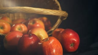 shopping basket with winter apple. fruits scattering from basket. colored apples closeup