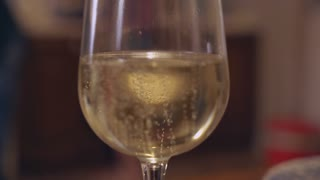 sparkling wine goblet. Wineglass with white bubbly
