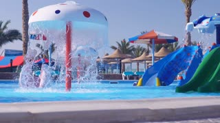 swimming pool for children with fountain and water slide