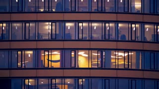 The windows of the big business center, evening time. Time lapse