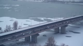 top view on the bridge with cars and train. Urban city view in winter
