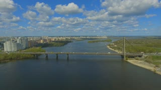 Traffic on the bridge over the river 4k video