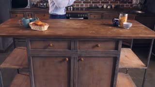 Young businessman enjoy freedom at home. Man dancing alone in the kitchen