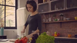 Woman cooking dinner in the kitchen. Young housewife on the kitchen