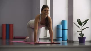 Woman doing exercises for legs on exercise mats