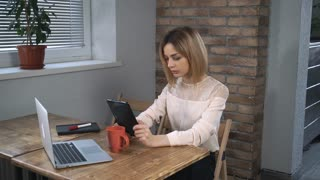Woman have video chatting with friend on her digital tablet