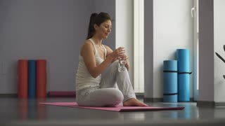 Woman In Gym relax and drinking  water