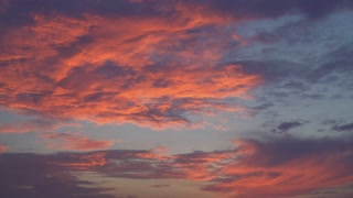 Wonderful sky in the evening with amazing colorful clouds bright red and blue. Beautiful cloudscape