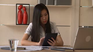 Worker in startup company use gadget in modern office. Young professional lady focused working at the table