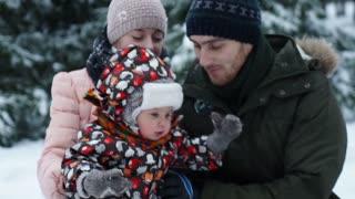 Attractive family having fun in a winter park