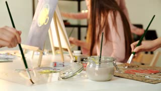 beautiful blonde woman painter in her studio 4k 20s