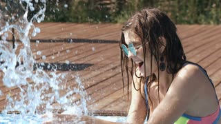 Beautiful woman having a fun while swimming in the lake Super Slow Motion 240fps