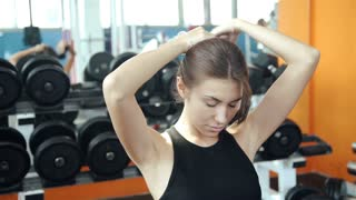 Beautiful woman stretching at the gym looking happy 20s. 1080p Slow Motion