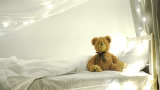 brown teddy bear lyiing sick in bed 4k