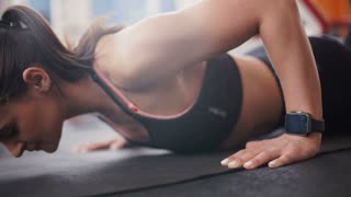 brunette woman at gym push up push-up workout exercise