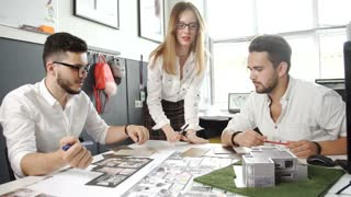 business people group on meeting and presentation in bright modern office with construction engineer architect and worker looking building model and blueprint planbleprint plans. 20s. 4k