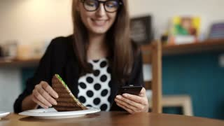 Cafe city lifestyle woman on phone eating sandwich