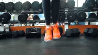Close up legs. Woman jumping with rope, jumping rope in a fitness club or gym. 20s. 1080p Slow Motion