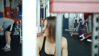 close up strong female back during work out at gym slow motion 20s. 1080p Slow Motion