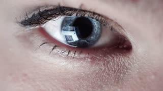 Closeup shot of boy eye surfing internet at night