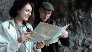 Couple hiking. Using map to get good direction,
