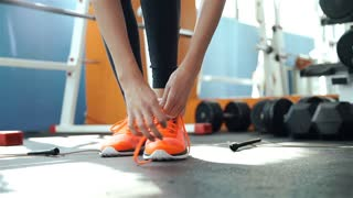 Girl tying shoelaces sneakers and takes a skipping rope 20s. 1080p Slow Motion