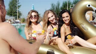 Group Of Friends Having Party In Pool Drinking Champagne. 20s. 1080p Slow Motion. Close up.