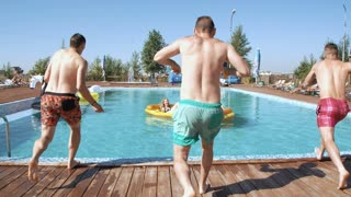 Guy splashed females while sunbathing when jumped in pool. 20s. Super 1080p Slow Motion 240fps.