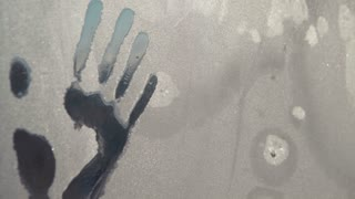 Hand prints in ice