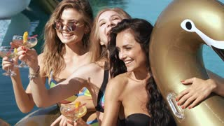 Happy girls with beverages on summer party near the pool. 20s. 1080p Super Slow Motion 240fps.