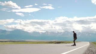 hipster man longboarding extremely action in highway tropics in Asia