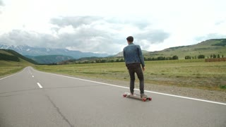 hipster man longboarding extremely action in highway.