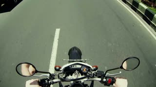 Man driving on moto on big speed on asphalt road