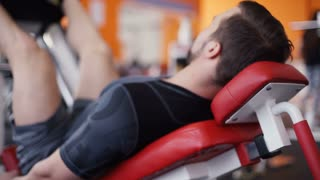 Man exercising on leg press machine