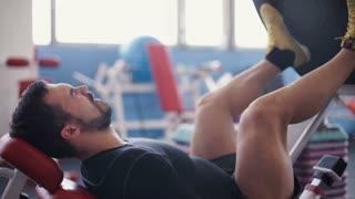 Man exercising on leg press machine