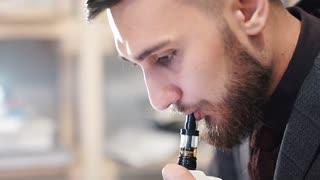 Man Exhaling smoke from a vaporizer 120 FPS three