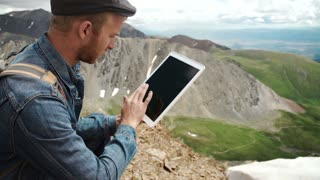 man working outdoors with tablet computer