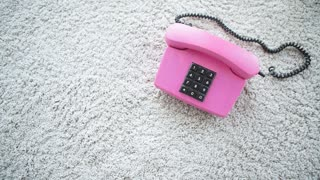 Retro pastel pink telephone