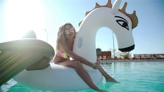 Sexy woman in bikini enjoying summer sun and tanning during holidays in pool with cocktail. Woman in swimming pool. Sexy woman in bikini 20s. 1080p Slow Motion.