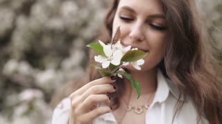 Slow Motion. Beautiful natural woman in the garden of apple