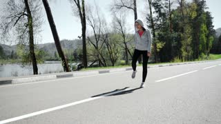 SLOW MOTION woman runner warm up outdoor