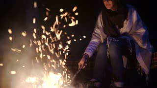 SLOWMOTION. Camping night couple cook by campfire backpack