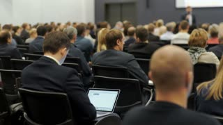 Speaker at Business Conference and Presentation. Audience at the conference hall. 4k.