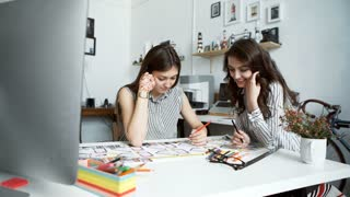 Two women working together at an architect office