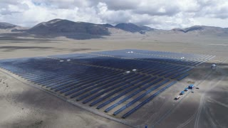 Aerial industrial view Photovoltaic solar units desert environment producing renewable energy, 4k slow motion aerial shot
